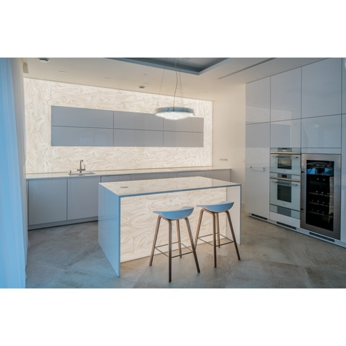 Kitchen and island illuminated Corian stone